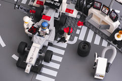 Lego MP4-29 race car in McLaren Mercedes Pit Stop Stock Photos
