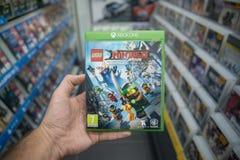 Lego Ninjago videogame on Microsoft XBOX One console. Bratislava, Slovakia, october 2, 2017: Man holding Lego Ninjago videogame on Microsoft XBOX One console in Stock Photos