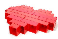 Lego Red Heart. Single Red Heart made of Lego Blocks Laying  on White Royalty Free Stock Photo