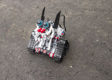 Lego robot stands on the asphalt Royalty Free Stock Photos