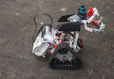 Lego robot stands on the asphalt Stock Photography