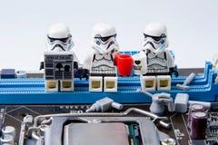 Lego star wars repairing computer motherboard. Stock Photo