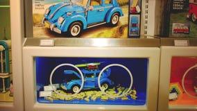 Lego store displays with vintage models of american diner restaurant , beetle car and hippie van