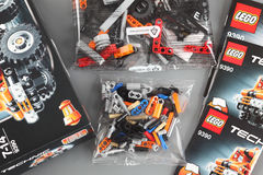 LEGO Technic set. Tambov, Russian Federation - April 06, 2013 LEGO Technic set with box, instructions and details in plastic packs on grey background. Item 9390 Royalty Free Stock Image
