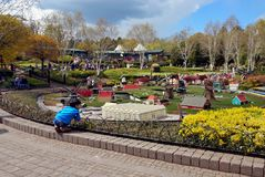 LEGOLAND, WINDSOR, UK - APRIL 30, 2016: A young boy looks at the lego models in Miniland.  Stock Photo