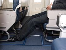Legroom on airliner. Extra legroom available on airlines stock photo