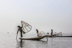Legrowing fisherman Stock Photos