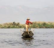 Legrowing fisherman Royalty Free Stock Photos