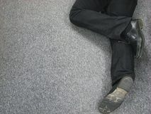 Legs. Photo of a working man legs, man on the floor royalty free stock images