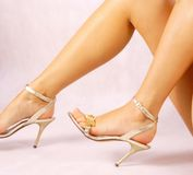 Legs. Beautiful woman legs in gold high heel shoes Stock Images