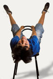 Legs in the air. Boy on a chair with his legs in the air Royalty Free Stock Photo