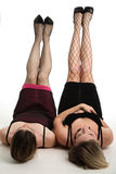 Legs in the air. Two women lying on the floor with their legs in the air Royalty Free Stock Photos