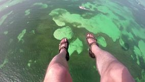 Legs in air parasailing stock video footage