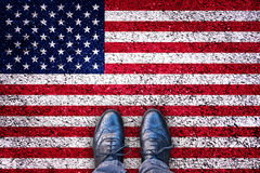 Legs on asphalt road with USA flag, american election concept. Ual image Royalty Free Stock Photo