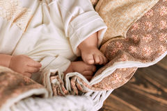 Legs of baby close up. Childish feet and blanket Stock Photography