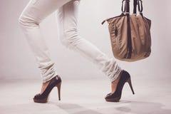 Legs and bag Stock Photos