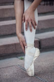 The legs of a ballerina. In ballet pointes (warm Royalty Free Stock Photography