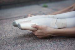 The legs of a ballerina. In ballet pointes (warm Stock Photos