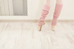 Legs of ballet dancer wearing gaiters closeup stock photography