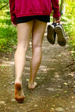 Legs with bare feet walking along the forest path Royalty Free Stock Photos