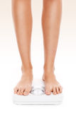 Legs on bathroom scales Royalty Free Stock Photography
