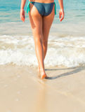 Legs on the beach. Royalty Free Stock Images