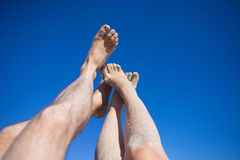 Legs on the beach Royalty Free Stock Photo