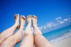 Legs on the beach Stock Images