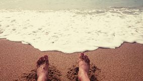 Legs on the beach Royalty Free Stock Photos