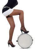 Legs of beautiful brunette and snare drum Stock Photo
