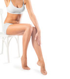 Legs of beautiful female sitting on chair Stock Photo