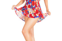 Legs of beautiful model covered with short preaty skirt. Stock Photography