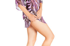 Legs of beautiful model covered with short preaty skirt. Stock Photos