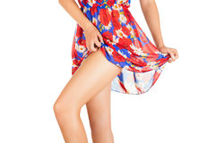 Legs of beautiful model covered with short preaty skirt. Royalty Free Stock Photography