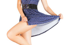 Legs of beautiful model covered with short preaty skirt. Royalty Free Stock Photos
