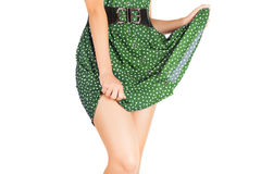 Legs of beautiful model covered with short pretty skirt. Royalty Free Stock Photos