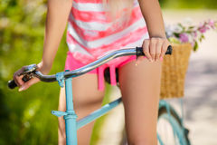 Legs of a beautiful woman on a bicycle Stock Photos