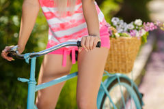 Legs of a beautiful woman on a bicycle Royalty Free Stock Photography