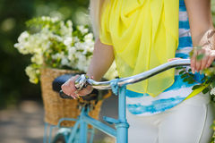 Legs of a beautiful woman on a bicycle Royalty Free Stock Photos
