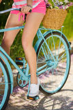 Legs of a beautiful woman on a bicycle Stock Photography