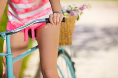 Legs of a beautiful woman on a bicycle Royalty Free Stock Photo
