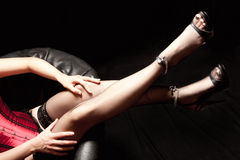 Legs of a beautiful woman in black stockings Royalty Free Stock Photography