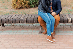 Legs of a beautiful young happy couple in love walking through the streets and parks of the city holding hands Royalty Free Stock Images