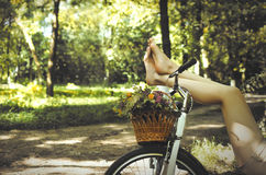Legs on a bicycle Royalty Free Stock Photography