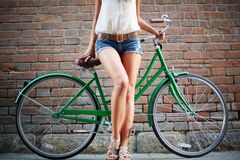 Legs of bicyclist Stock Images