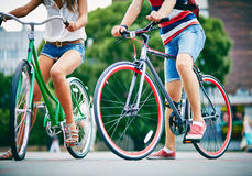 Legs of bicyclists Stock Images