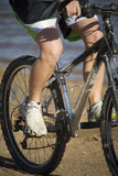 Legs on bike Stock Photos
