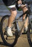 Legs on bike Stock Photos
