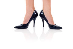 Legs with black high heels Stock Photography
