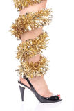 Legs and black high heels. Legs with christmas decorations and black high heel shoes Royalty Free Stock Photos